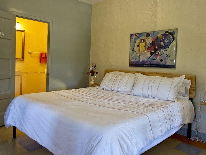 room 201 bed and door to bathroom
