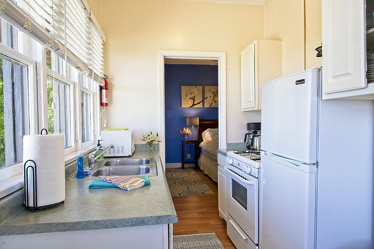 room 208 kitchen looking into bedroom